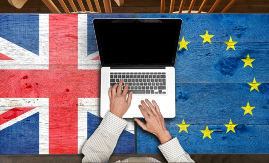 European and UK flagged wooden Table with laptop